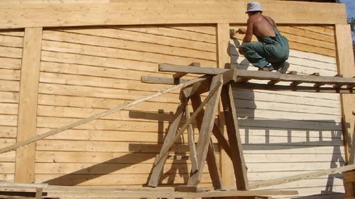 Окраска деревянного фасада грунтование