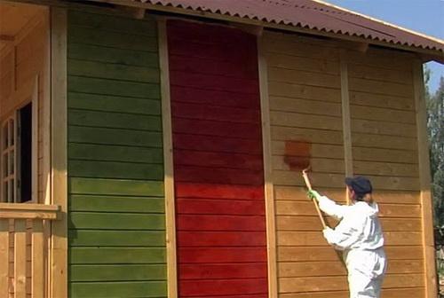 Окраска деревянного фасада