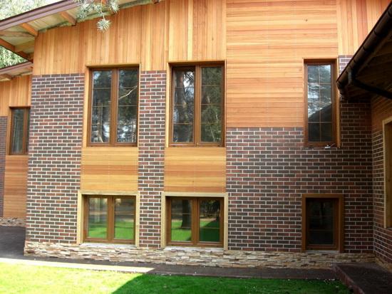 Отделка фасада деревянного дома клинкер