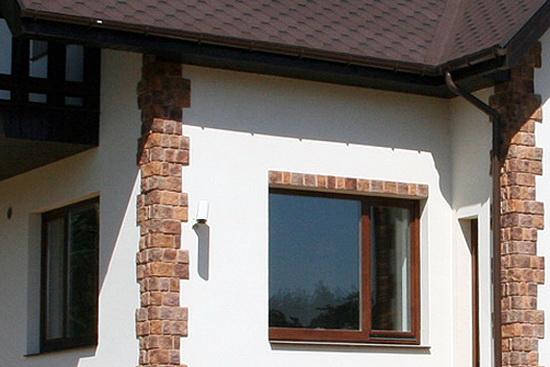 Отделка фасада дома штукатуркой 1