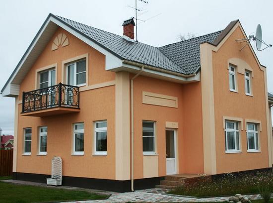 Отделка фасада дома штукатуркой 2