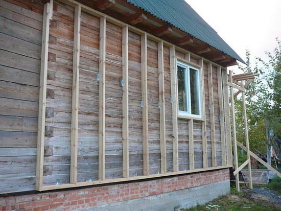 Утепление стен брусового дома снаружи эковатой 1