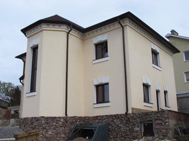 отделка фасада дома камнем и штукатуркой фото 4