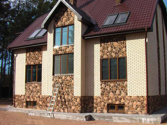 отделка фасада дома панелями под камень фото 0