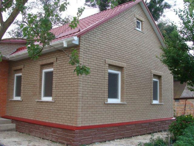 отделка фасада дома панелями под камень фото 10