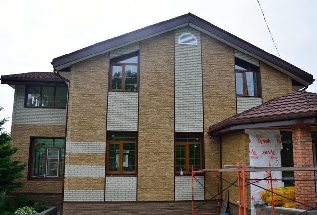 отделка фасада дома панелями под камень фото 8