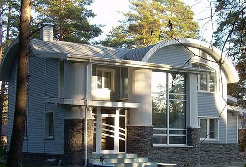 Отделка фасада дома сайдингом 4