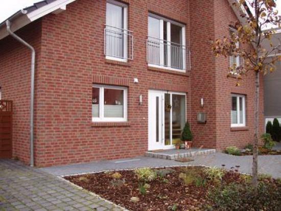 Дизайн фасада домов из кирпича фото
