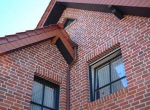 Наружная отделка фасада под кирпич