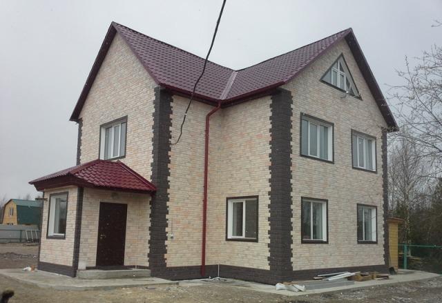 отделка фасада дома панелями под камень фото 11