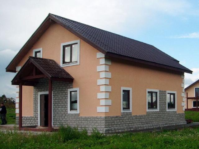 Красивые фасады кирпичных домов и коттеджей на фото 2